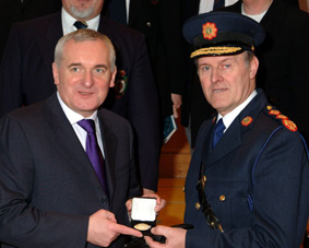 Taoiseach presenting first Ireland Medal